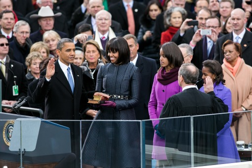 Supreme Court Chief Justice John G. Roberts, Jr. administers the oath of office to President Barack Obama during the inaugural swearing-in ceremony at the U.S. Capitol in Washington, D.C., Jan. 21, 2013. First Lady Michelle Obama holds a Bible that belonged to Dr. Martin Luther King Jr., and the Lincoln Bible, which was used at President ObamaÕs 2009 inaugural ceremony. Daughters Sasha and Malia stand with their parents.  (Official White House Photo by Sonya N. Hebert)